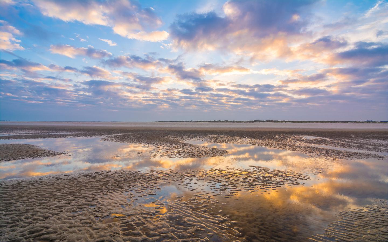 Während eines Nordsee-Urlaubs ist das Wattenmeer ein beliebtes Ausflugsziel.